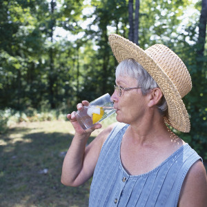 Lady drinking a glass of water