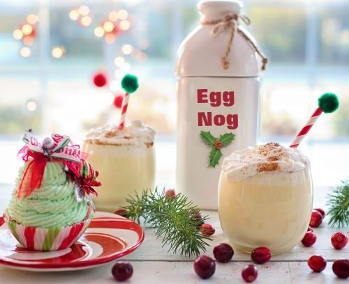 Eggnog with cranberries and Christmas themed decorations