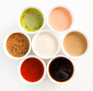 7 different sauces in small containers