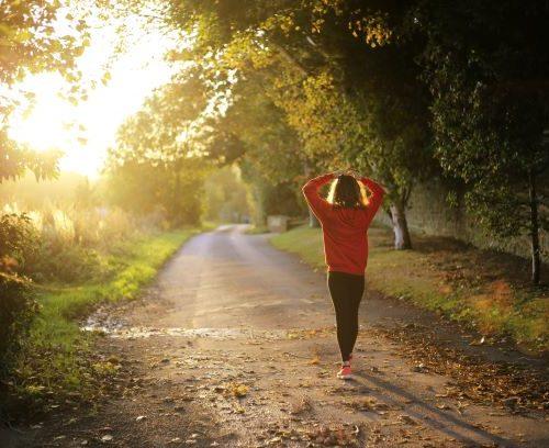 Girl walking on road