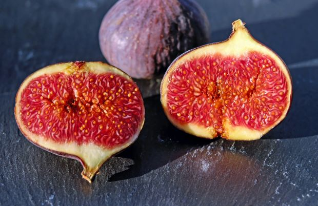 Two Figs, one sliced open