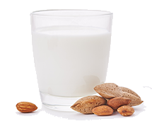 Almond in glass with almonds to the side