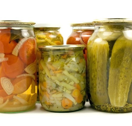 Cans of pickles, and other cans of vegetables