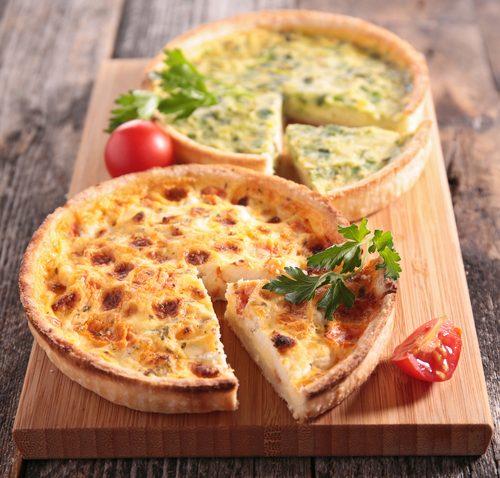 Quiche pie on wooden cutting board