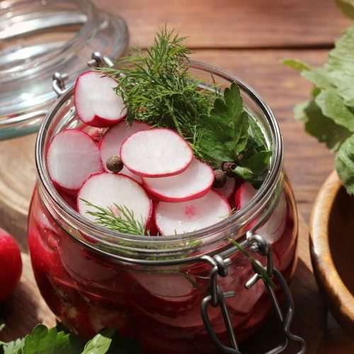 pickled radishes in glass jar