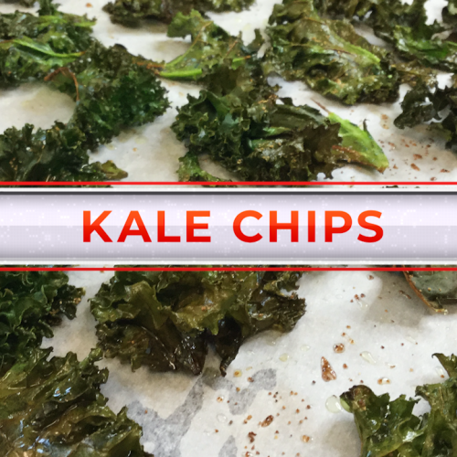 "baked kale on parchment paper with the title ""Kale Chips"" over image in red text"