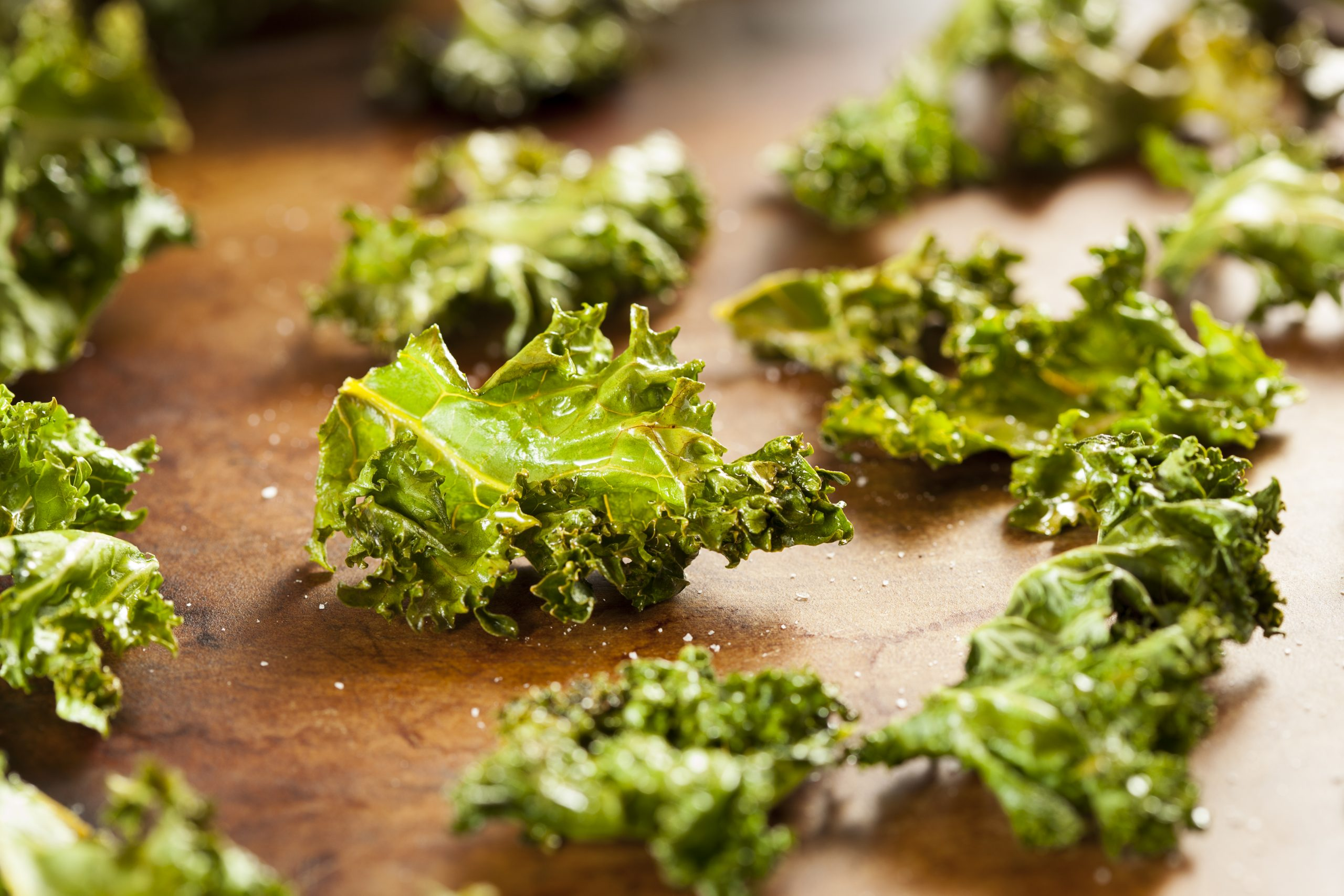 baked kale on wooden table