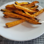 piles of fries on white plate