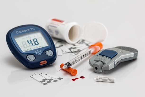 Blood glucose test kit, medications, needle, and blood strips