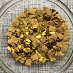 snack mix in glass bowl on placemat