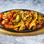 Chicken Fajita on skillet and hot plate