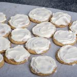 frosted cookies on parchment paper