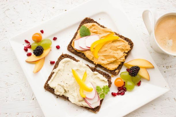 whole wheat bread with nut spread and fruit on the side