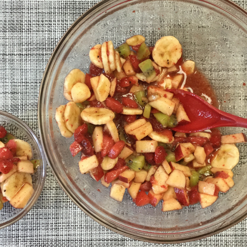 mix of chopped fruits in a large and small glass bowl