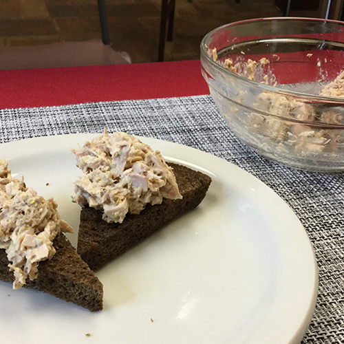 tuna salad crisps on white plate and red tablecloth