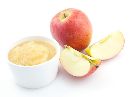 Apples with bowl of applesauce